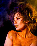 Golden powder cosmetics on bare woman shoulders with decorative Royalty Free Stock Photography