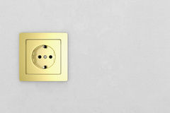 Golden power plug on white wall Stock Image