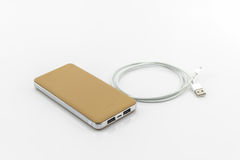 Golden powerbank. Stock Photo