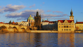 Golden Prague. Vltava river, Carles bridge and Prague towers in morning light Royalty Free Stock Photo