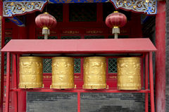 Golden prayer wheels Royalty Free Stock Images