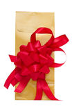 Golden present bag with red ribbon Royalty Free Stock Photos