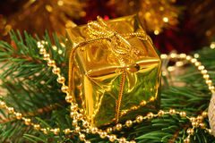 Golden present box Royalty Free Stock Images
