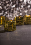Golden present box, gift package, glitter bokeh background Stock Images