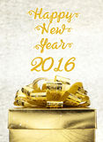 Golden Present box with Happy New Year 2016 word at bokeh light. Background, Holiday concept Royalty Free Stock Photography