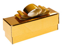 Golden present box with yellow ribbon Stock Image