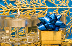 Golden present with candle Royalty Free Stock Image