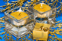 Golden present with candle Royalty Free Stock Photos