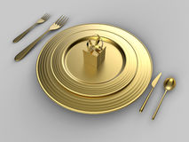 Golden present on a plate Stock Images