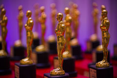 Golden Prize Statues. Group of Shiny Golden Prize Statues stock photo