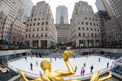 Golden Prometheus statue and Rockefeller Center ice skate rink, Manhattan, New York City, USA. New York City, USA - March. 2015: Golden Prometheus statue and Stock Image