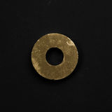 Golden puck gasket isolated on black background Stock Photography