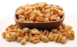 Golden puffed wheat. In bowl over white background royalty free stock images