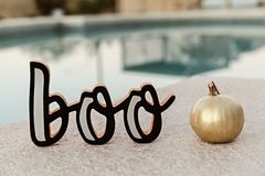 Golden Pumpkin And Boo Sign. Halloween Celebration stock image