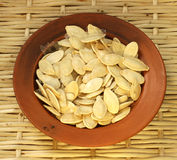 Golden pumpkin seeds Royalty Free Stock Image
