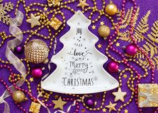 Golden and purple Christmas decorations. Top view Stock Images