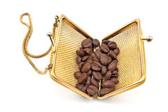 Golden purse with coffee beans Stock Images