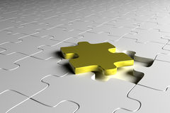 Golden puzzle piece Royalty Free Stock Photography