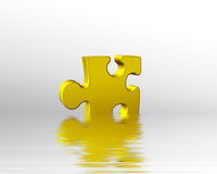 Golden puzzle piece in water Royalty Free Stock Image