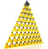 Golden pyramid. With unique one Royalty Free Stock Photo