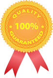 Golden quality badge with ribbon. Stylized golden quality badge with two red ribbons Stock Photography