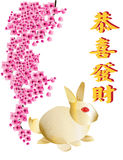 Golden rabbit on white background. A greeting for Chinese Rabbit New Year 2011 Royalty Free Stock Photo