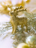 Golden raindeer decoration for the Christmas tree Royalty Free Stock Image