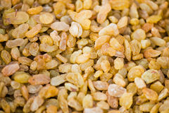 Golden raisins background Stock Photos