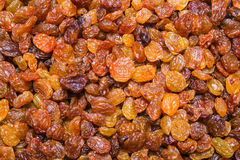 Golden Raisins background, texture Stock Photo