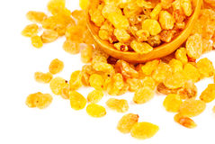 Golden raisins close- up and wooden spoon,  on white background Stock Photo