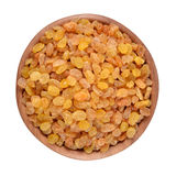 Golden raisins in a wooden bowl Royalty Free Stock Image