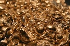 Golden Raw Nuggets. Golden Nuggets Macro image from a jewelers stash. This is the raw materials for rings and such Stock Photography