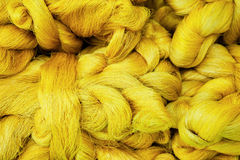Golden raw silk pile Stock Images