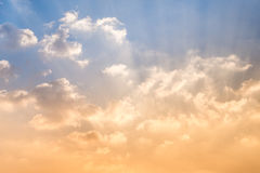 Golden rays shine clouds Royalty Free Stock Photo