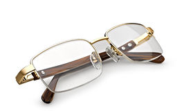 Golden reading glasses Royalty Free Stock Photo