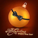 Golden realistic christmas decoration ball with bowtie Royalty Free Stock Photos