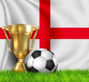 Golden realistic winner trophy cup and soccer ball isolated on national ENGLAND flag. National team is the winner of the football. Cup winner in the form of a stock illustration