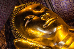 Golden reclining buddha face Royalty Free Stock Images