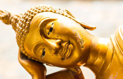 Golden reclining Buddha. Stock Photos