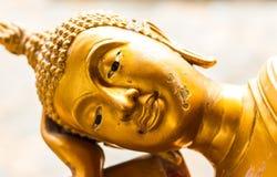 Golden reclining Buddha. Old golden reclining Buddha statue Stock Photos
