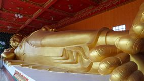Golden Reclining Buddha Stock Image