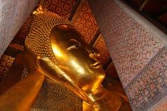 Golden Reclining Buddha statue. Royalty Free Stock Photography