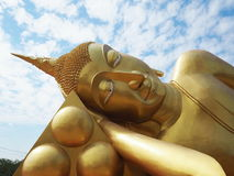Golden Reclining Buddha statue at outdoor royalty free stock photography