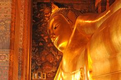 Golden reclining buddha statue,Thailand Stock Images