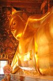Golden reclining buddha statue,Thailand Royalty Free Stock Photo