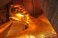 Golden reclining buddha statue,Thailand Stock Image