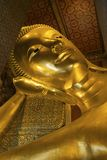 Golden reclining Buddha statue in Wat Pho, Bangkok Royalty Free Stock Image