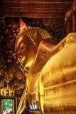 Golden reclining Buddha statue at the Wat Pho Temple, Bangkok, Thailand Stock Photography