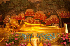 Golden reclining buddha in Thai church. Royalty Free Stock Photo