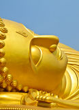 A golden  reclining buddha Royalty Free Stock Photo